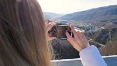 Woman take photos of the scenery nature views on the skybridge over the canyon Stock Footage