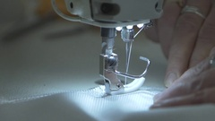 Sewing-machine needle slow-mo Stock Footage