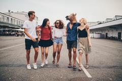 Multiracial young friends having fun together on the street Stock Photos
