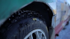 Wheel sports car closeup. Studded tires for winter racing. Live camera Stock Footage