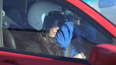 Girl in a helmet smiles in the passenger seat Stock Footage