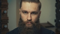 Portrait of handsome serious unshaven guy with long beard Stock Footage