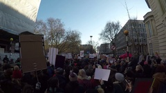 4K Dolly in shot of anti Trump rally outside US Embassy London inauguration Stock Footage
