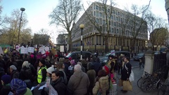 4K stabilized Pan from crowd of anti Trump to US Embassy London Stock Footage