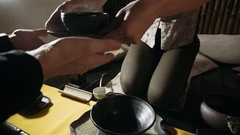 Tea bowl in the hands of the guest.Tea ceremony Stock Footage