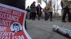 4K Low angle of anti Trump protesters US Embassy London Stock Footage