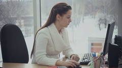 Attractive woman working with computer in office Stock Footage