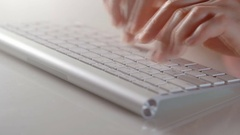 Technology and programming concept - close up of hands typing on computer Stock Footage