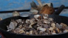 Sliced ceps in a frying pan Stock Footage