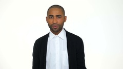 Surprised african business man in formalwear staring at camera Stock Footage
