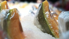 Cantaloupe wrapped in plastic pack on ice in supermarket. Ready to eat fruit Stock Footage
