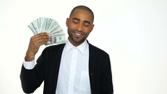 Business man in formalwear holding money and waving Stock Footage