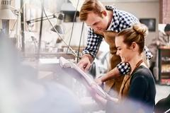 Jewelers reviewing plans in workshop Stock Photos