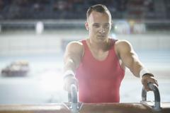 Focused male gymnast at pommel horse Stock Photos