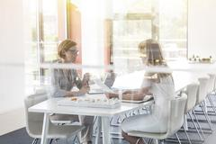 Female architects meeting in conference room Stock Photos