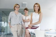 Portrait confident female architects in conference room Stock Photos