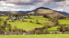 Hilly Green Pastures of Snowdonia in North Wales, UK Stock Footage