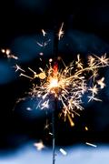 Sparkling fire stick with particles Kuvituskuvat