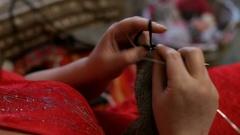 Woman knitting needles.woman knits mittens Stock Footage