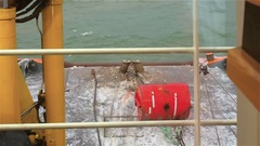 View from the bridge deck of the tug on anchor buoy. Powered winch. Daytime Stock Footage