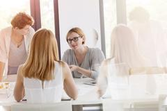Businesswomen meeting in conference room Stock Photos
