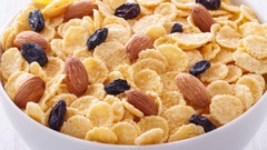 Breakfast of cornflakes on a wooden background. Stock Footage