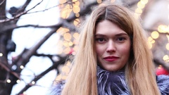 Young blonde woman in blue fur coat, outdoor in winter Stock Footage