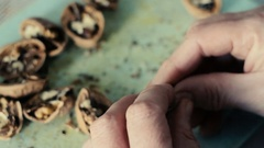 Female hand cut up walnuts Stock Footage