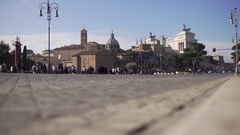 Bottom shot of Via dei Fori Imperiali Rome with tourists and Altar of Fatherlan. Stock Footage
