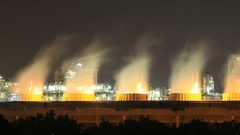 Time-lapse of Cooling tower of oil refinery industrial plant at night, Thailand Stock Footage