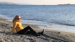 Middle aged woman resting at winter beach Stock Footage