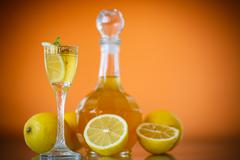 Sweet lemon alcoholic brandy in the decanter Stock Photos