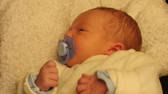 Laying few days old newborn baby with papilla Stock Footage