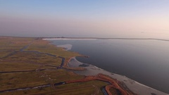 Land and frozen lake in Holland, aerial footage. Stock Footage