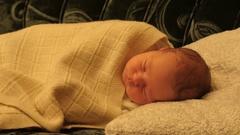 Removed curtain showing deep sleeping newborn baby Stock Footage