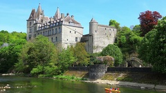 Kayak sails past the castle in the city Durbuy Stock Footage