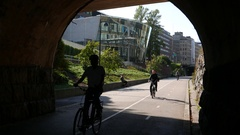 Several bicycle run at lowered lanes, bikeway and pedestrian path Baana Stock Footage