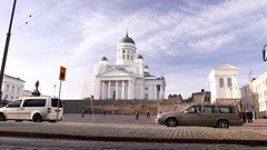 Modern tramway vehicle pass against Helsinki Cathedral, ride at Senate Square Stock Footage