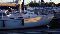 Front part of small sailing yacht, stand at marina, early morning time Stock Footage
