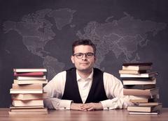 Geography teacher at desk Stock Photos