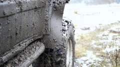 Very dirty jeep with a wide tread in the mud and the snow on the nature, slow Stock Footage