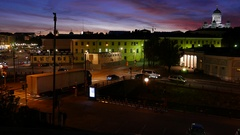 Two trucks pass small automobile bridge, European city at night, top point view Stock Footage