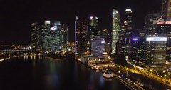 Aerial view Singapore skyscrapers at night. Flying above Singapore`s business Stock Footage