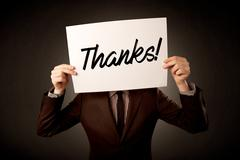 Businessman holding paper expressing gratitude Stock Photos