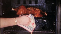 The turkey is almost ready for Thanksgiving dinner, 3985 vintage film home movie Stock Footage