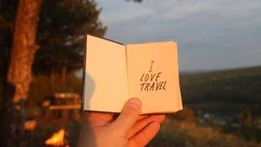 I love Travel concept. Book with with motivational inscription. Forest in the Stock Footage