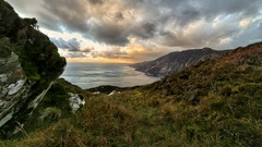 Clouds over cliffs in  Ireland time lapse Stock Footage