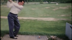 Men work on their golf swing at the local driving range 3990 vintage home movie Stock Footage
