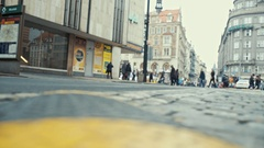 A quick movement of people and trams streets of old European city Stock Footage