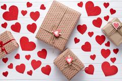 Gifts of Valentines Day, a Birthday. Romantic creative white wooden background Stock Photos